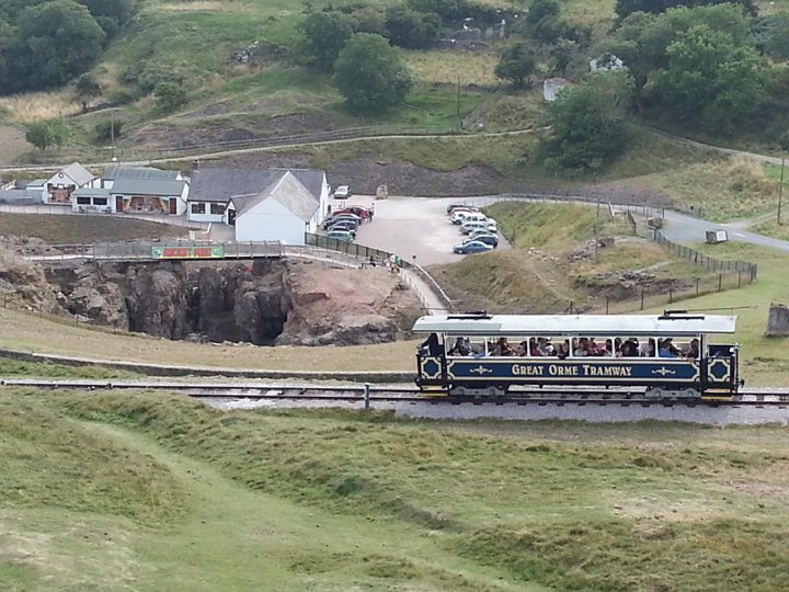 View of site with visitor centre and tram